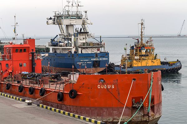 ODESSA, UKRAINE - 28 April: pilot tug towing a large sea cargo s